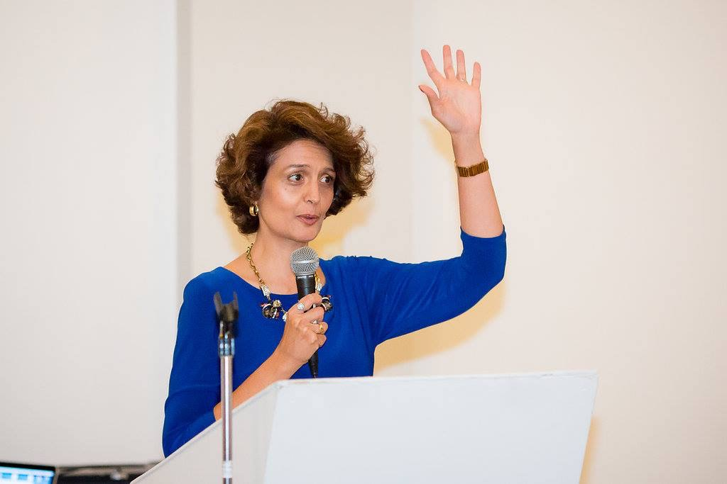 A photo of Narges Emceeing an event