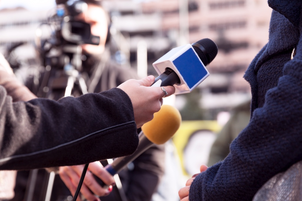 A picture of a media interview
